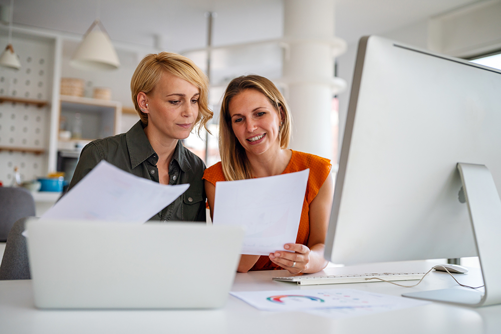 Business women working at the office on computer grgypt7