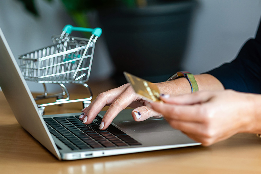 Close up of a woman hands buying online with a cre 6kmzw7v